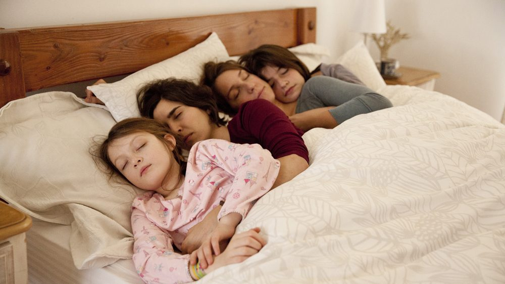 The four of them in bed